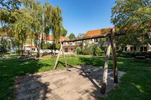 Inakindergarten, Kitaportrait, Preussstrasse, Außenanlage mit Spielplatz